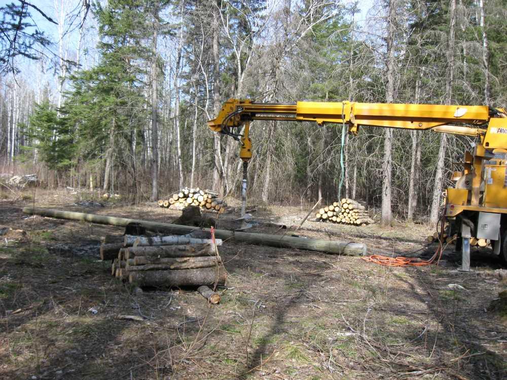 John Kundert's Manitoba Nudist Scrapbook: Gallery 07/03...Hydro installs poles for the power line