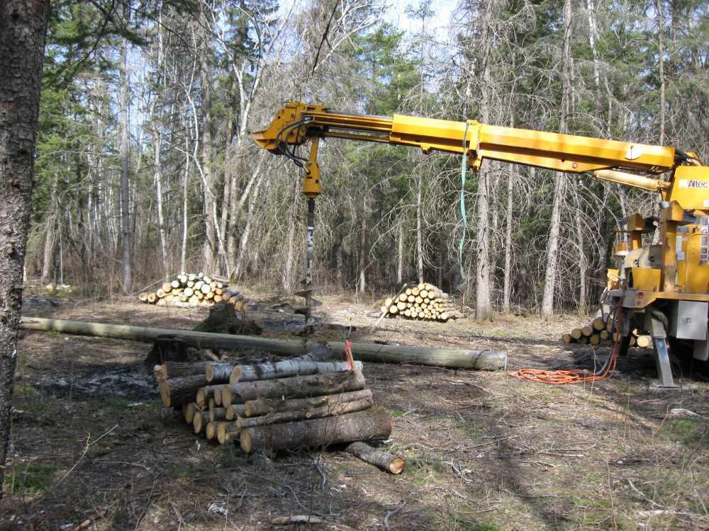 John Kundert's Manitoba Nudist Scrapbook: Gallery 07/04...Hydro installs poles for the power line