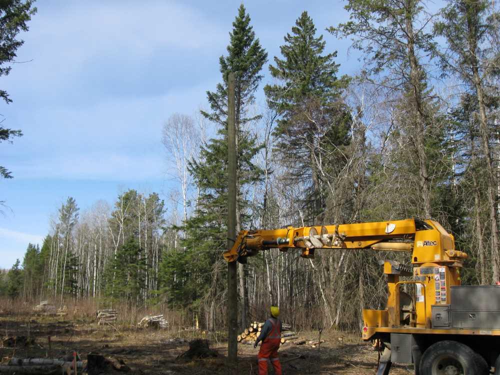 John Kundert's Manitoba Nudist Scrapbook: Gallery 07/11...Hydro installs poles for the power line