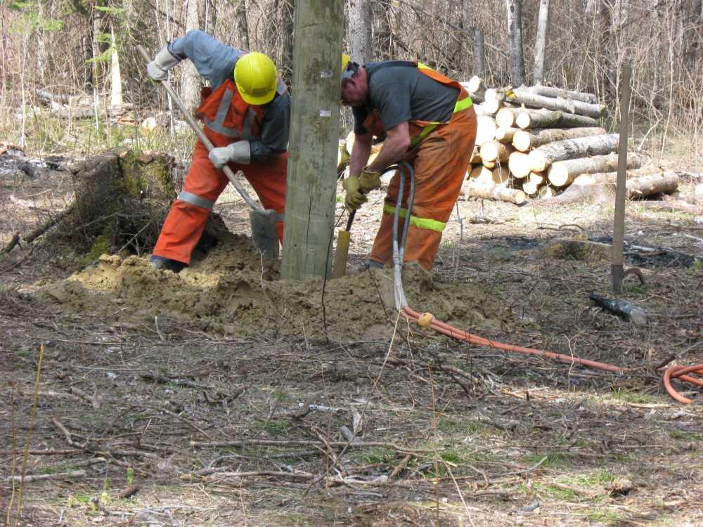 John Kundert's Manitoba Nudist Scrapbook: Gallery 07/13...Hydro installs poles for the power line