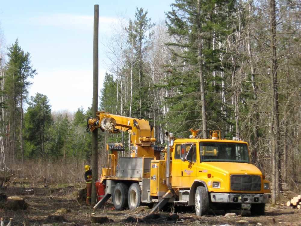 John Kundert's Manitoba Nudist Scrapbook: Gallery 07/14...Hydro installs poles for the power line