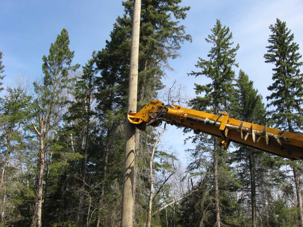 John Kundert's Manitoba Nudist Scrapbook: Gallery 07/22...Hydro installs poles for the power line