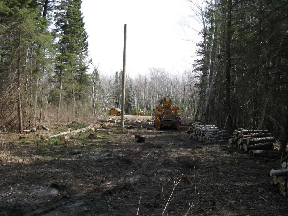 John Kundert's Manitoba Nudist Scrapbook: Gallery 07/23...Hydro installs poles for the power line