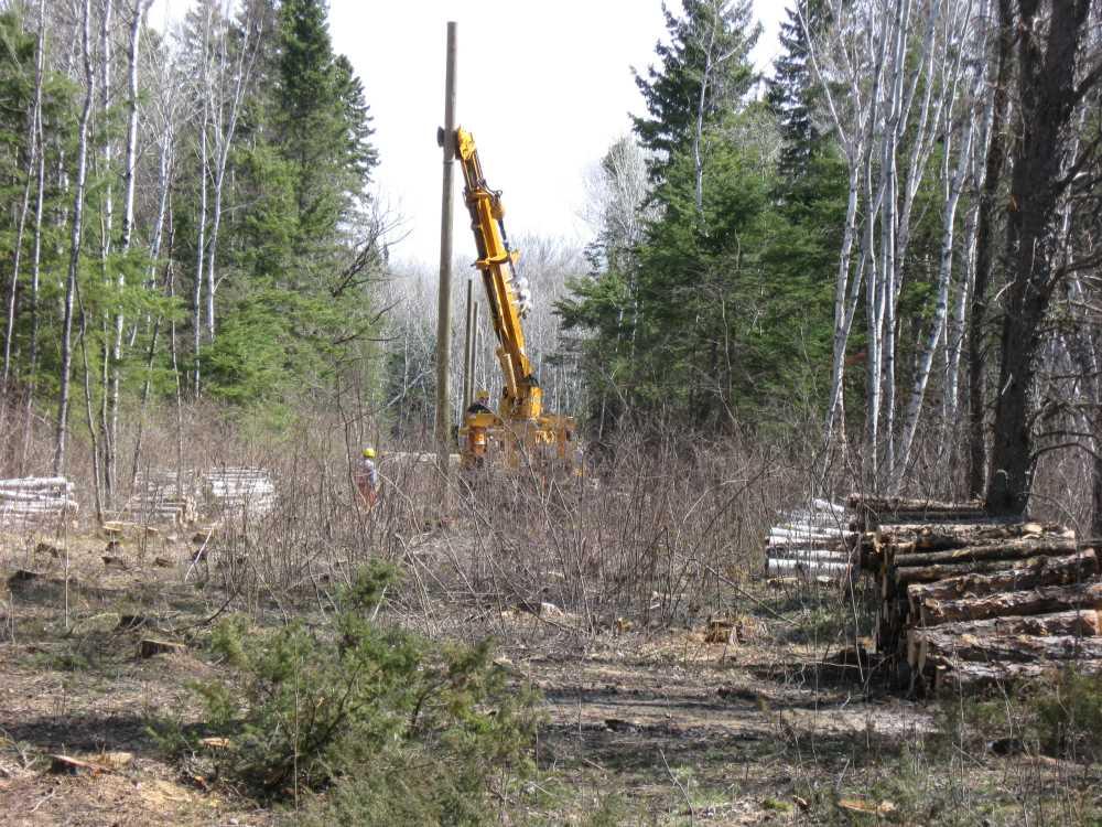 John Kundert's Manitoba Nudist Scrapbook: Gallery 07/26...Hydro installs poles for the power line