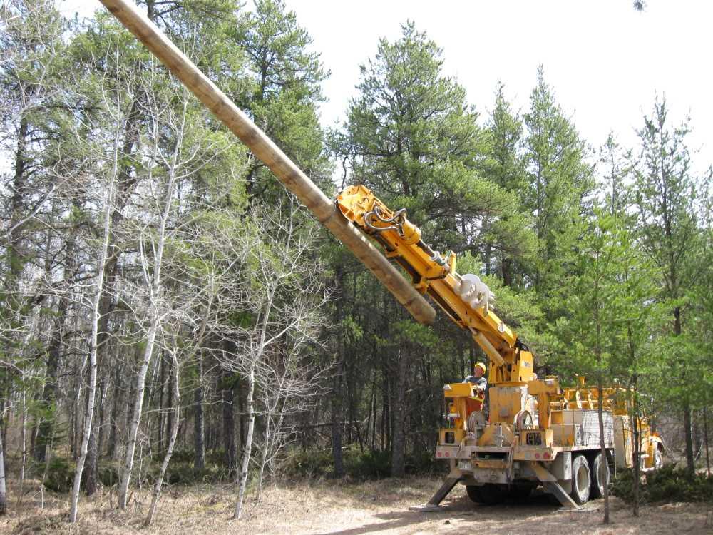 John Kundert's Manitoba Nudist Scrapbook: Gallery 07/27...Hydro installs poles for the power line