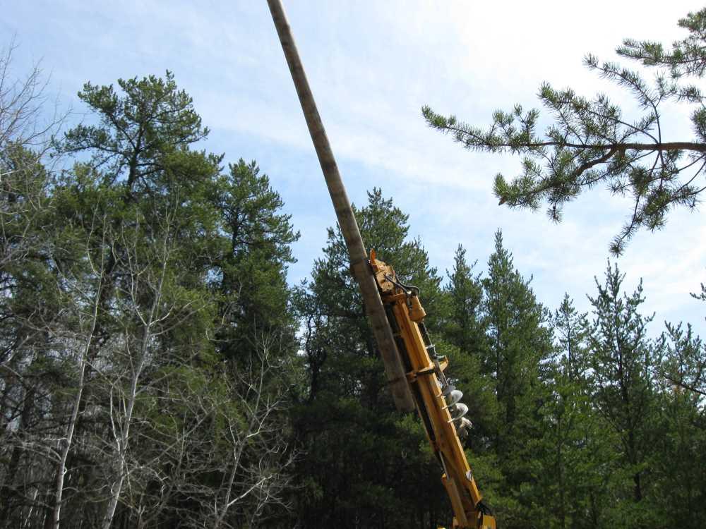 John Kundert's Manitoba Nudist Scrapbook: Gallery 07/28...Hydro installs poles for the power line