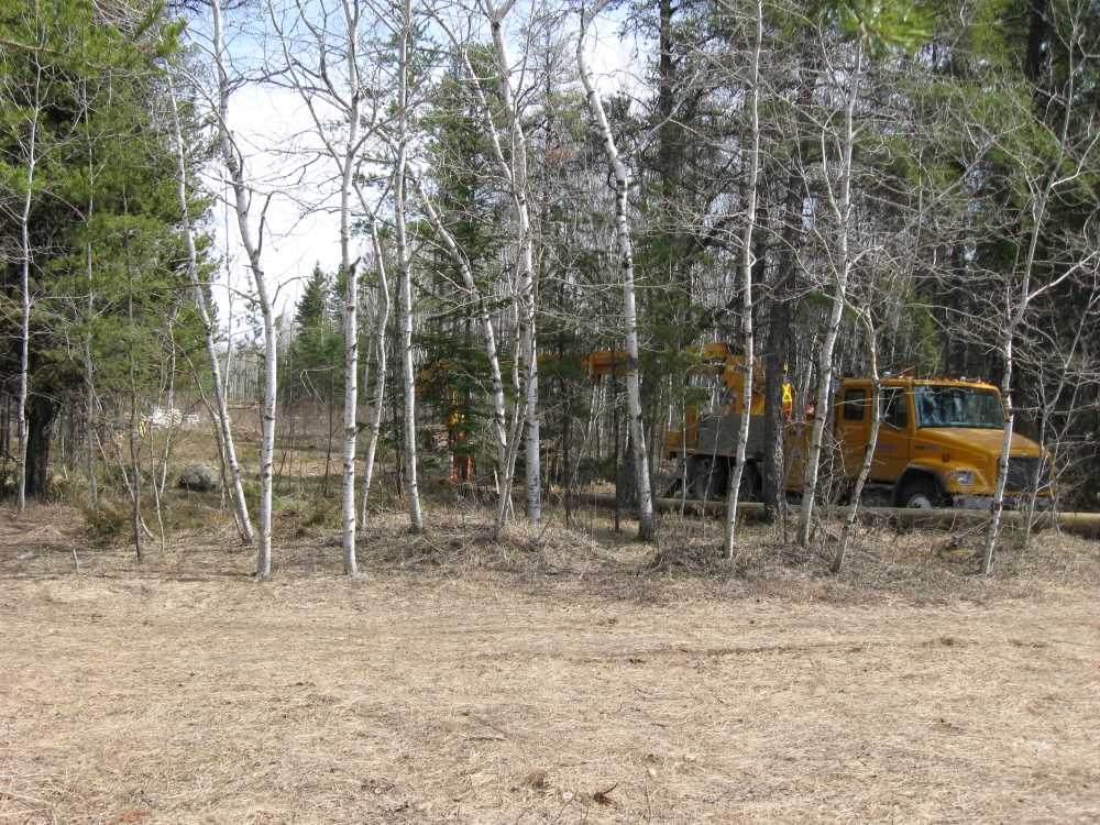 John Kundert's Manitoba Nudist Scrapbook: Gallery 07/31...Hydro installs poles for the power line