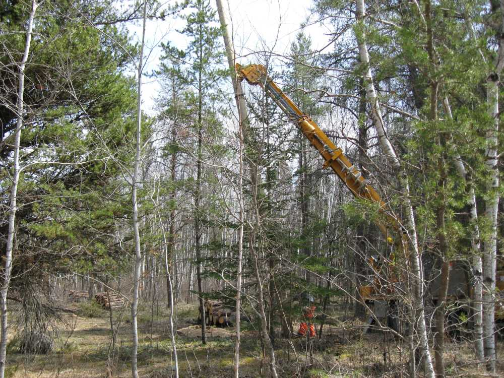 John Kundert's Manitoba Nudist Scrapbook: Gallery 07/35...Hydro installs poles for the power line