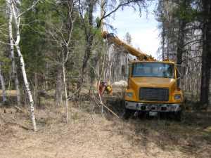 John Kundert's Manitoba Nudist Scrapbook: Gallery 07/37...Hydro installs poles for the power line