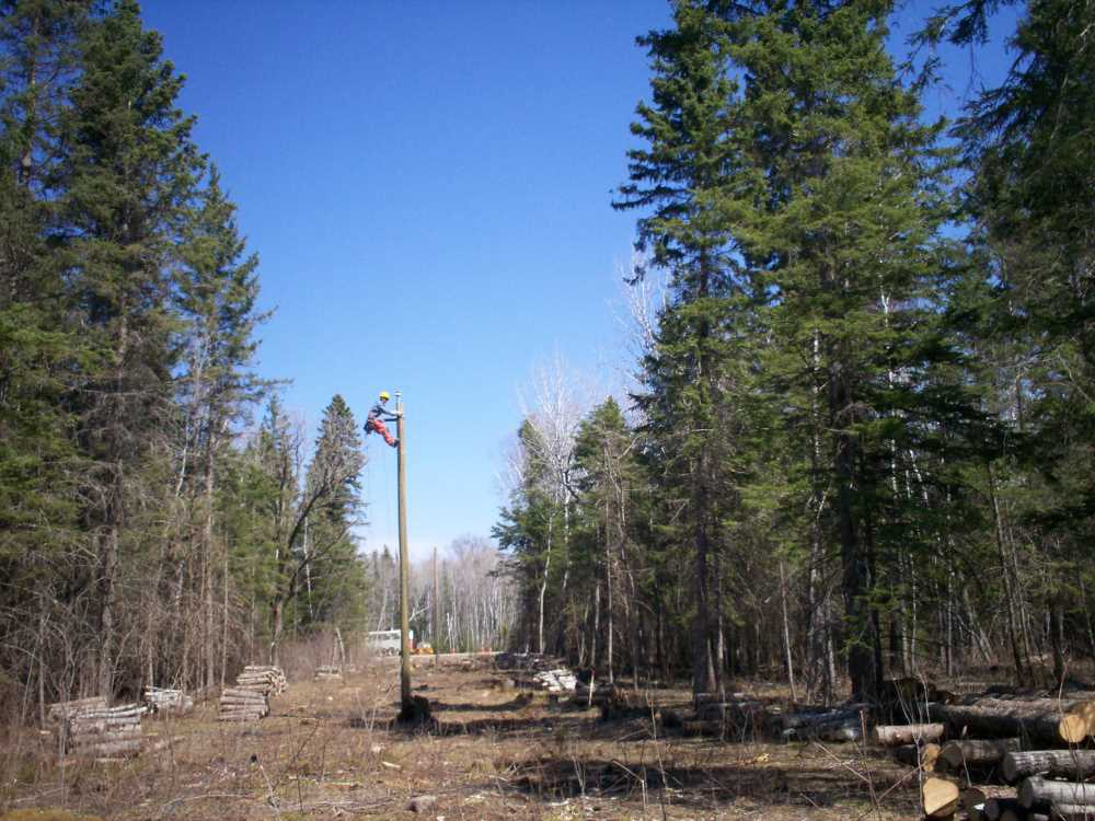 John Kundert's Manitoba Nudist Scrapbook: Gallery 08/04...Hydro installs wires and a transformer