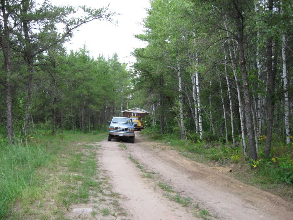 John Kundert's Manitoba Nudist Scrapbook: Gallery 16.1/08...Another cottage is moved to Naturist Legacy Park