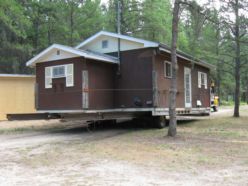 John Kundert's Manitoba Nudist Scrapbook: Gallery 16.1/13...Another cottage is moved to Naturist Legacy Park