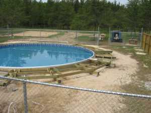 John Kundert's Manitoba Nudist Scrapbook: Gallery 26/06...Building a splash deck for the pool