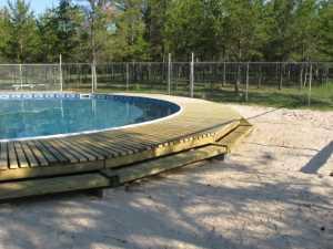 John Kundert's Manitoba Nudist Scrapbook: Gallery 26/14...Building a splash deck for the pool