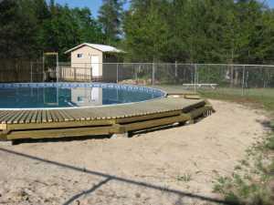 John Kundert's Manitoba Nudist Scrapbook: Gallery 26/16...Building a splash deck for the pool