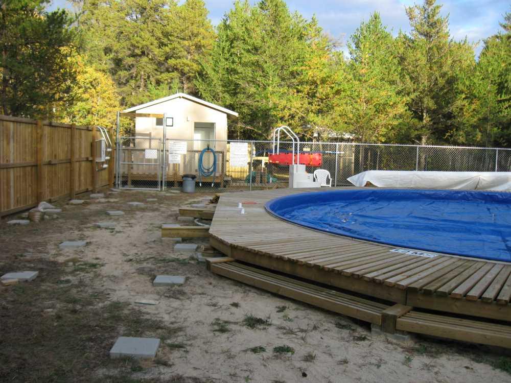 John Kundert's Manitoba Nudist Scrapbook: Gallery 32/02...Work begins on the new sun deck