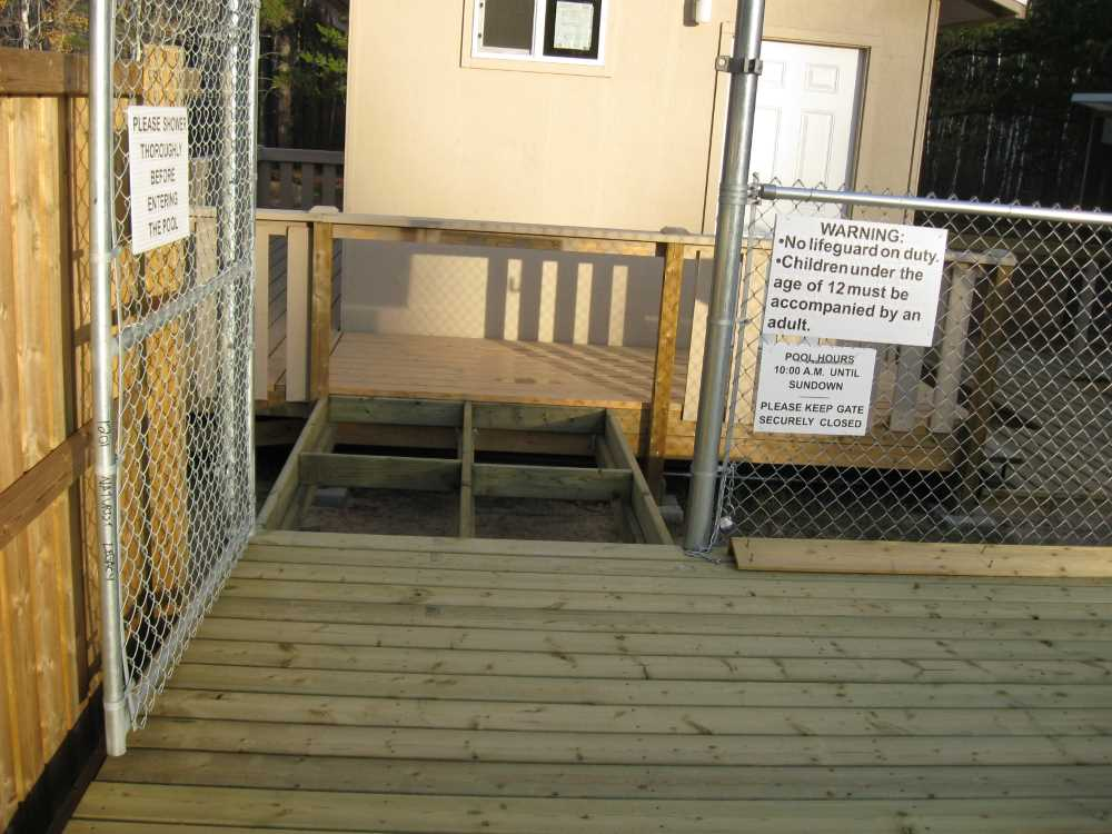 John Kundert's Manitoba Nudist Scrapbook: Gallery 33/01...The sun deck is joined to existing decks