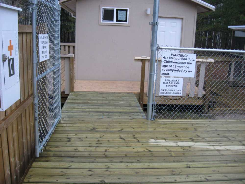 John Kundert's Manitoba Nudist Scrapbook: Gallery 33/02...The sun deck is joined to existing decks