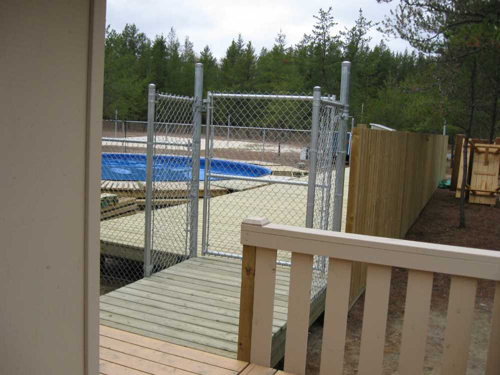 John Kundert's Manitoba Nudist Scrapbook: Gallery 33/07...The sun deck is joined to existing decks