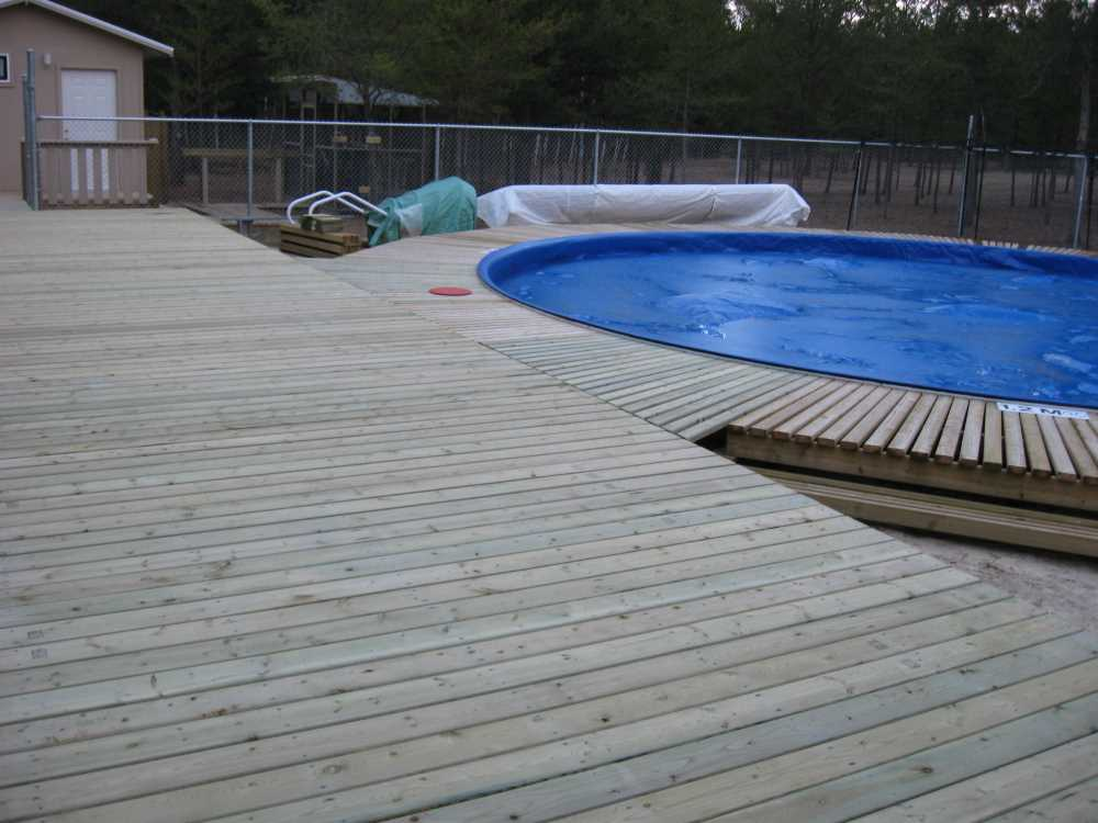John Kundert's Manitoba Nudist Scrapbook: Gallery 33/12...The sun deck is joined to existing decks
