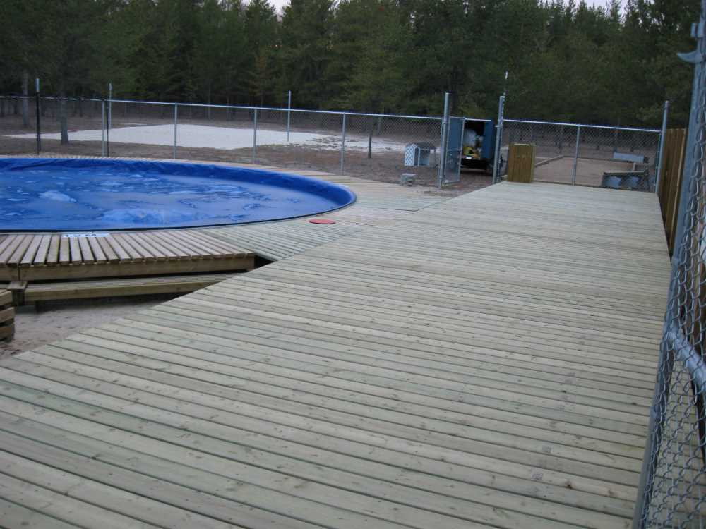 John Kundert's Manitoba Nudist Scrapbook: Gallery 33/13...The sun deck is joined to existing decks