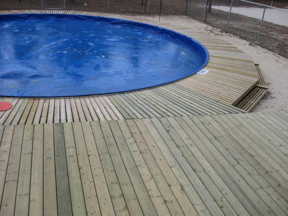 John Kundert's Manitoba Nudist Scrapbook: Gallery 33/14...The sun deck is joined to existing decks