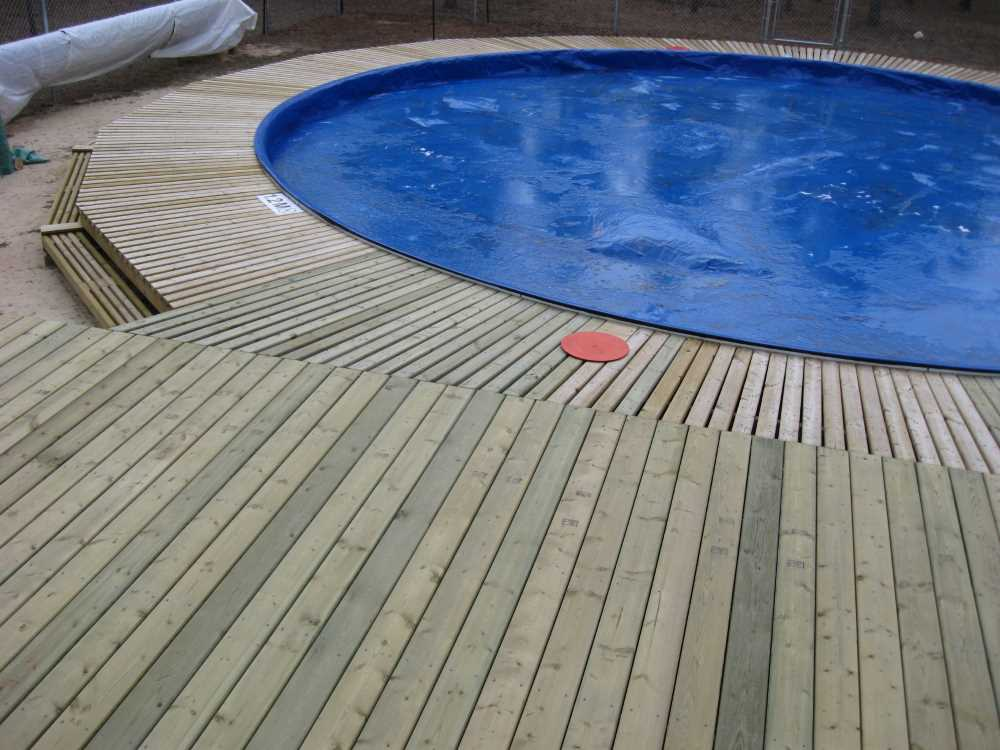 John Kundert's Manitoba Nudist Scrapbook: Gallery 33/15...The sun deck is joined to existing decks