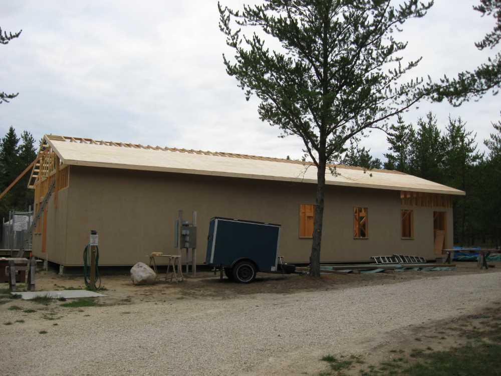John Kundert's Manitoba Nudist Scrapbook: Gallery 39/01...Plywood sheathing and metal roofing applied