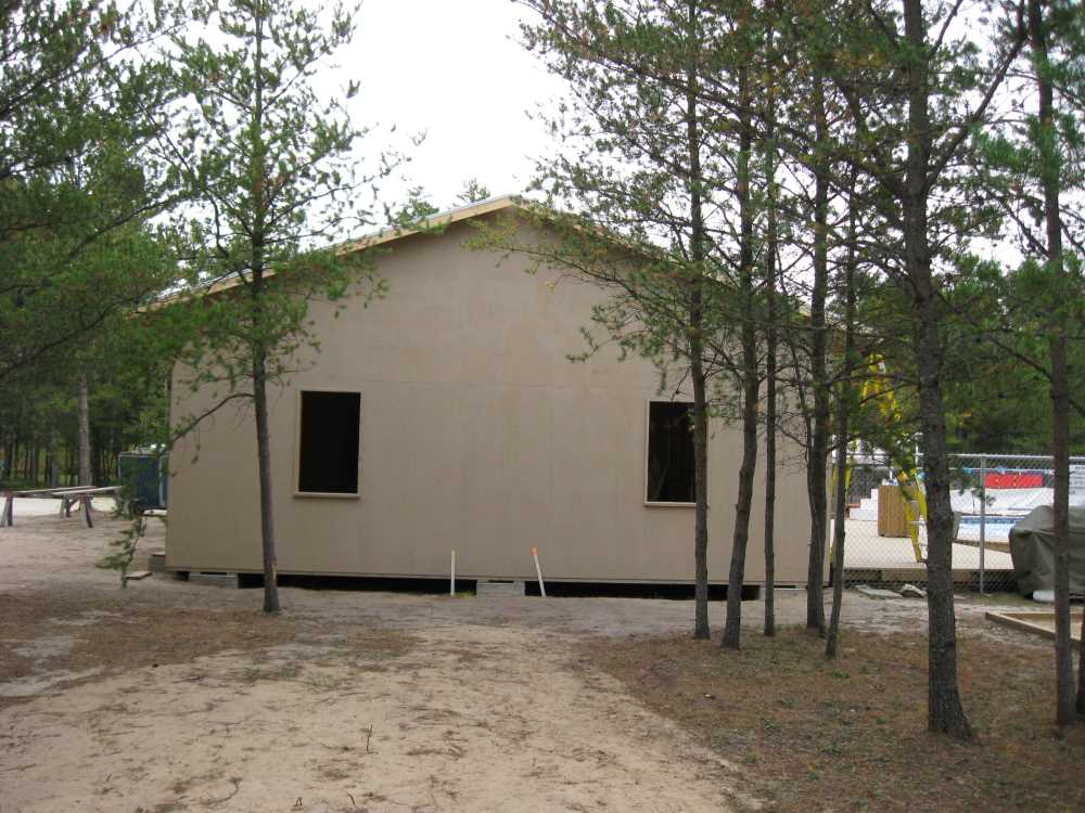 John Kundert's Manitoba Nudist Scrapbook: Gallery 39/14...Plywood sheathing and metal roofing applied