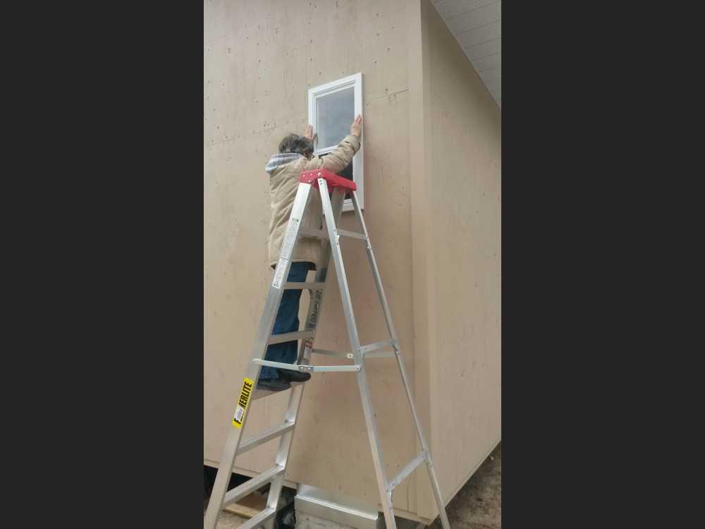 John Kundert's Manitoba Nudist Scrapbook: Gallery 42/02...Windows, deck railings, etc. completed