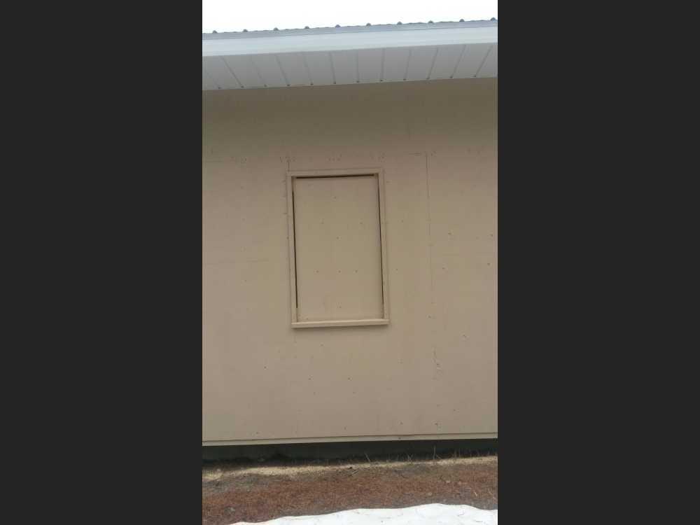 John Kundert's Manitoba Nudist Scrapbook: Gallery 42/04...Windows, deck railings, etc. completed